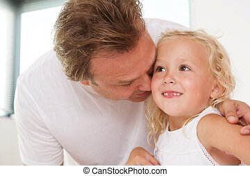 Loving father with his cute little daughter at home