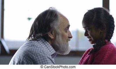 Loving granddad bonding cute granddaughter at home -...