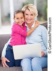 loving granddaughter hugging grandmother
