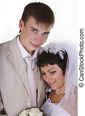 Loving groom and beautiful bride are happy together.