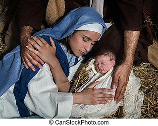 Loving hands in nativity scene