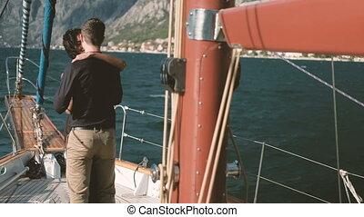 Loving happy couple dancing on yacht walk on lake outdoors