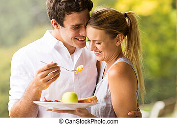 husband feeding wife breakfast - loving husband feeding wife...