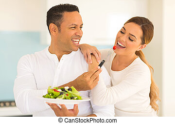 husband feeding wife salad