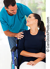 loving husband talking to handicapped wife
