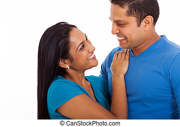 loving indian couple looking each other - cute loving indian...