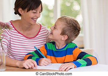 Loving little boy smiling at his mother