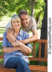 Loving man embracing woman in park