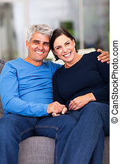 loving mature couple relaxing at home