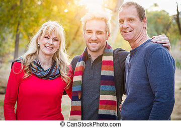 Loving Middle Aged Parents and Young Son Portrait Outdoors