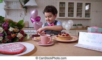 Loving mixed race son preparing holiday breakfast -...