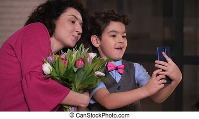 Loving mom and son grimacing for selfie on phone - Happy...