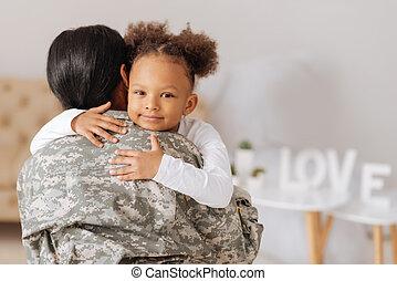 Loving mom returning home to her child