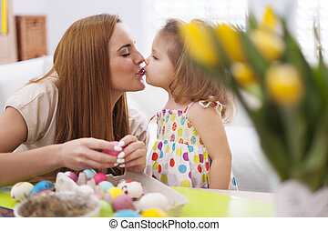 Loving mother and baby in easter time