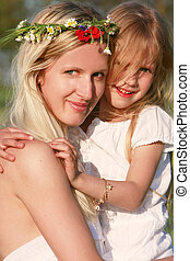 loving mother and daughter outdoors portrait