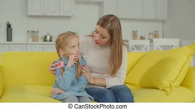 Loving mother comforting her sad daughter at home - Loving...