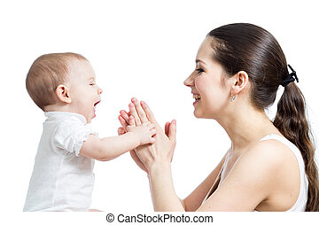 Loving mother having fun with her baby girl