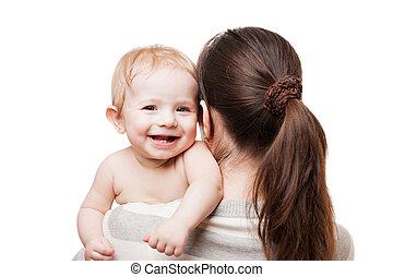 Loving mother holding little newborn smiling baby child