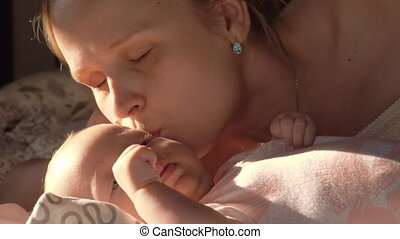 Loving mother kissing baby