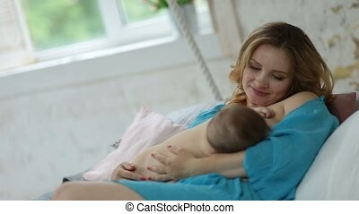 Loving mother looking at her adorable baby girl