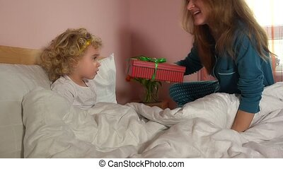 Loving mother woman give present for her sweet toddler girl....
