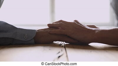 Loving older mature woman stroking hand of middle aged ...