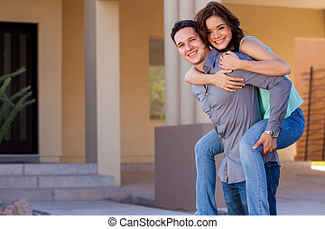 Loving our new house - Attractive Hispanic couple arriving...