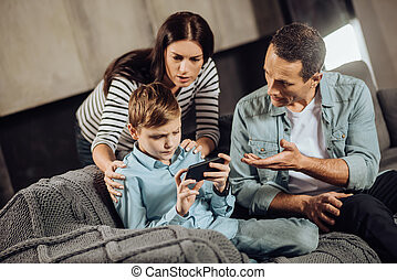 Loving parents convincing son to put down the phone - Stop...
