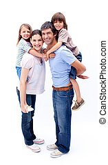 Loving parents giving their children a piggyback ride