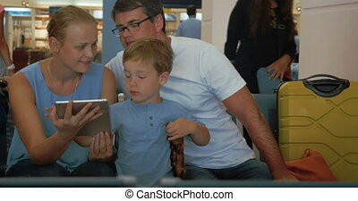 Loving Parents, Son and Tablet PC - Son is showing to his...