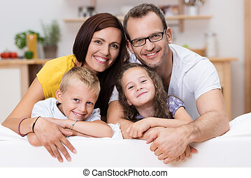 Loving parents with their son and daughter - Loving parents...