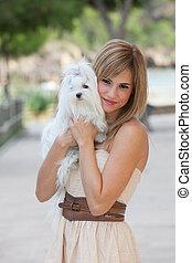 loving pet owner holding dog