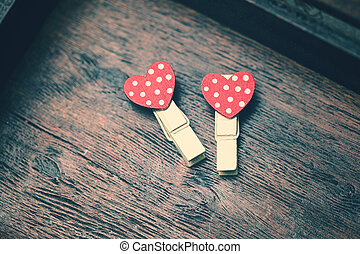 loving red hearts on vintage wooden background. Valentines day concept.
