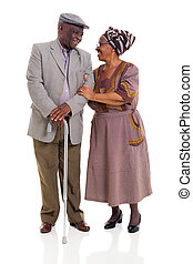 senior african couple looking one another