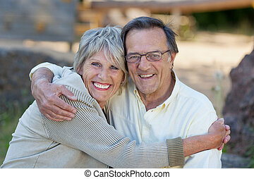 Loving Senior Couple Embracing In Park