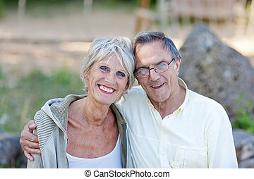 Loving Senior Couple Smiling In Park