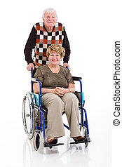 senior man with his disabled wife