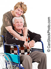 loving senior wife hugging disabled husband on white background