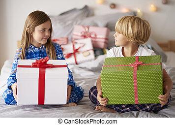 Loving siblings with big Christmas presents