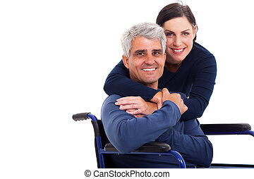 loving supportive wife hugging handicapped husband isolated on white