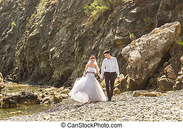 loving wedding couple on the beach, bride and groom