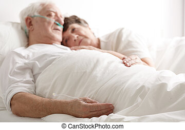 Loving wife hugging sick husband