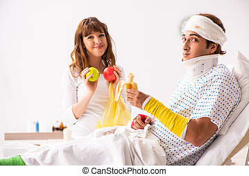 Loving wife looking after injured husband