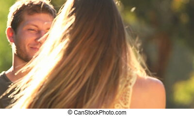 Loving young couple dancing outdoor