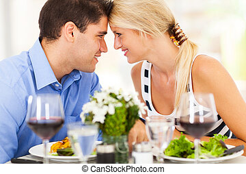 loving young couple dining out in restaurant
