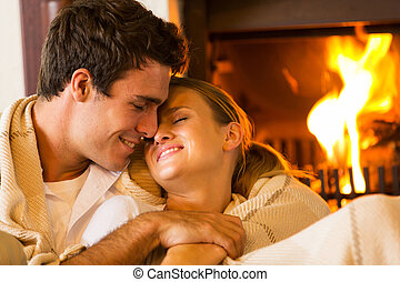 young couple embracing at home - loving young couple...