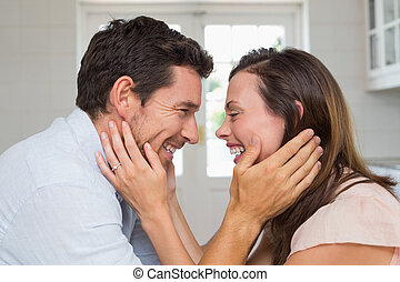 Loving young couple looking at each other - Side view of a...