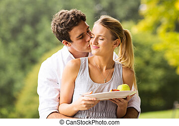 young man kissing girlfriend