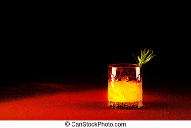 Low alcohol drink in a glass beaker on Oxy Fire background. The concept of new popular drinks. Close up