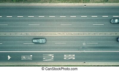 Low altitude aerial top down view of city highway with bus...